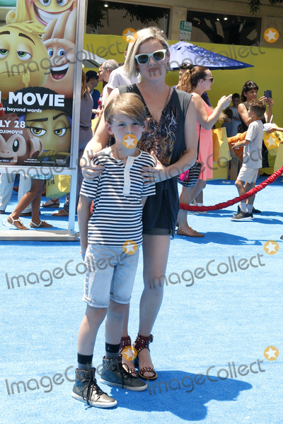 Photo - LOS ANGELES - JUL 23  William Robert Cowles_Kathleen Robertson at The Emoji Movie Premiere at the Village Theater on July 23 2017 in Westwood CA