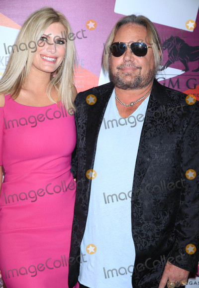 Photo - Photo by Raoul GatchalianstarmaxinccomSTAR MAX2017ALL RIGHTS RESERVEDTelephoneFax (212) 995-119642717Rain Hannah and Vince Neil at Keep Memory Alives  21st Annual Power of Love Gala at MGM Grand Garden Arena in Las Vegas Nevada