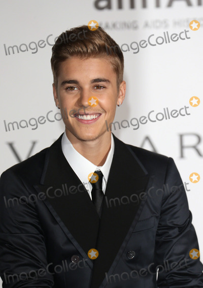 Justin Bieber Photos - May 21 2014 CannesJustin Bieber arriving at amfARs 21st Cinema Against AIDS Gala during the 67th Cannes International Film Festival at Hotel du Cap-Eden-Roc on May 21 2014 in Cap dAntibes France