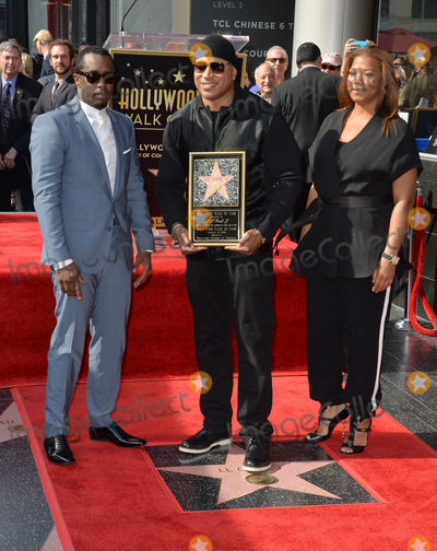 Diddy Combs Photo - Recording staractor LL Cool J with Sean Diddy Combs  Queen Latifah on Hollywood Boulevard where LL Cool J was honored with the 2571st star on the Hollywood Walk of FameJanuary 21 2016  Los Angeles CAPicture Paul Smith  Featureflash