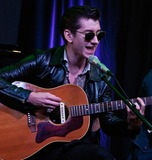 Alex Turner Photo - BALA CYNWYD PA - SEPTEMBER 18  Alex Turner of the British Alternative Rock Band Arctic Monkeys Performs at Radio 1045s Performance Theatre on September 18 2013 in Bala Cynwyd Pennsylvania  (Photo by Paul J FroggattFamousPix)