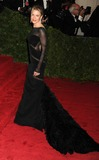 Renee Zellweger Photo - Renee Zellweger arriving at the Costume Institute Benefit held at the Metropolitan Museum of Art to celebrate the opening of Schiaparelli and Prada Impossible Conversations New YorkDennis Van Tinestarmaxinccom