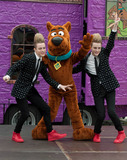 Scooby Doo Photo - Jedward X-Factor 2009 contestants and twins John and Edward Grimes pose with Scooby-Doo at the Battersea Dogs and Cats Home Joined onstage by a canine pal the brothers and the beloved cartoon character celebrated the launch of the new Scooby-Doo themed Mystery Mansion and the release of the new movie Scooby-Doo Camp Scare along with the video game Scooby-Doo and the Spooky Swamp  The new television series Mystery Inc on Boomerang was also celebrated at the event London UK 101810