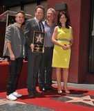 Frankie Muniz Photo - Bryan Cranston with Frankie Muniz Linwood Boomer  Jane Kaczmarek on Hollywood Walk of Fame where Bryan Cranston was presented with the 2502nd star on the Hollywood Walk of FameJuly 16 2013  Los Angeles CAPicture Paul Smith  Featureflash