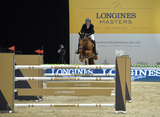 Alejandro Karolyi Photo - Alejandro Karolyi (Venezuela) riding Arena du Pachis ET in the Antoine Mouex Proprits International jumping competition at the 2015 Longins Masters Los Angeles at the LA Convention CentreOctober 1 2015  Los Angeles CAPicture Paul Smith  Featureflash