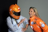 Kim Crosby Photo - Female Nascar driver Kim Crosby (R) and photographer Marili Forestieri during a photo shoot in Chelsea Kim Crosby is wearing her new sponsor Vassarette Lingeries new driving suit while Ms Forestieri dons the new helmet August 23 2005 in New York City August 23 2005  Fernando Leon  Retna Ltd