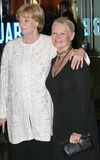 Judi Dench Photo - London Dame Maggie Smith and Dame Judi Dench arrive at the film premiere of Ladies in Lavender in Leicester Square08 November 2004Paulo PirezLandmark Media