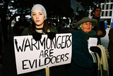 JFK Photo - Anti-war demonstration JFK Memorial Dallas Tx 02-15-03 16 year old Stacy Yarbrough of Burleson TX joins her grandmother Fort Worth Weekly editor Betty Brink to protest possible US Military in Iraq Ms Brink was there to cover the protest as well as to participate Quote from Ms Brink I am an old anti-war activistPHOTOJEFF NEWMAN  GLOBE PHOTOS INC 2003K29136JN