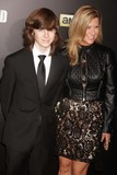 Chandler Riggs Photo - Chandler Riggs and Mother at Amc Season Six Debut of the Walking Dead at Fan Premiere Event at Madison Square Garden 10-9-2015 John BarrettGlobe Photos