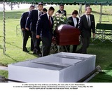 Bonnie Lee Bakley Photo - A Coffin Bearing the Body of Bonny Lee Bakley the Slain Wife of Actor Robert Blake Is Carried by Unidentified Pallbearers During a Brief Funeral Ceremony in Los Angeles Friday May 25 2001 Photo Supplied by Globe Photos Incap Pool