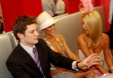Rob Mills Photo - Rob Mills (Australian Idol Reject) with Paris and Nicky Hilton -Attend the Melbourne Cup 2003 in Melbourne Australia 1142003 Photo Bydave MorganalphaGlobe Photos Inc 2003