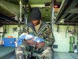 David Jones Photo - 030402-M-8664K-001NASIRIYAH Iraq -- Chief Hospital Corpsman David Jones of the 15th Marine Expeditionary Unit (Special Operations Capable) (15th MEU (SOC)) holds the two-hour- old newborn Rogenia Katham daughter of Jamila Katham  The infant was born in the Battalion Landing Team 21s Battalion Aid Station after arriving at the 15th MEUs position  KnollUSMCGLOBE PHOTOS INCK29852