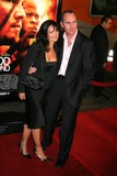 Arnold Vosloo Photo - Blood Diamond Los Angeles Premiere Graumans Chinese Theatre Hollywood CA 12-06-2006 Arnold Vosloo and Guest Photo Clinton H Wallace-photomundo-Globe Photos Inc