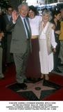 Carroll OConnor Photo -  Carroll Oconnor Honored with a Star on the Hollywood Walk of Fame 03172000 Carroll Oconnor Danielle Brisbois and Betty Garrett Photo by Fitzroy BarrettGlobe Photos Inc