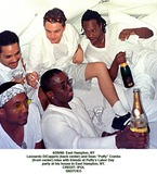 Sean Puffy Combs Photo - 2998 East Hampton NY Leonardo Dicapprio (Back Center) and Sean Puffy Combs (Front Center) Relax with Friends at Puffys Labor Day Party at His House in East Hampton NY Credit Ipol I2627cko Credit PhotographeripolGlobe Photos Inc