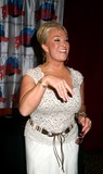 Karen Will Rogers Photo - K37863MLTANYA TUCKER MAKES A SPECIAL APPEARANCE AT PLANET HOLLYWOOD FOR A BOOK SIGNING TO HELP PHOTOGRAPHER KAREN WILL ROGERS AND LAURA LACY PROMOTE THEIR BOOK MUSIC ROW DOGS AND NASHVILLE CATS TIMES SQUARE NEW YORK CITY 06152004PHOTO MITCHELL LEVY  RANGEFINDERS  GLOBE PHOTOS INC  2004