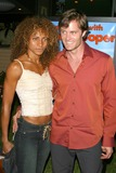 Michelle Hurd Photo - a Minute with Stan Hooper - Premiere Party Norms Diner Los Angeles CA 10212003 Photo by Milan Ryba  Globe Photos Inc 2003 Garret Dillahunt and Michelle Hurd