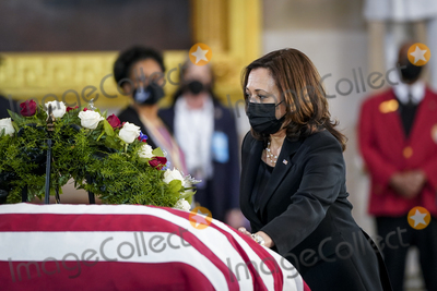 Photo - WASHINGTON DC - APRIL 13 United States Vice President Kamala Harris touches the casket as she pays her respects to the late US Capitol Police officer William Billy Evans as he lies in honor in the Rotunda at the US Capitol on April 13 2021 in Washington DC Officer Evans was killed in the line of duty during the attack outside the US Capitol on April 2 He is thesixthCapitol Police officer to die in the line of duty in the nearly 200 years since the force was createdCredit Drew Angerer  Pool via CNPAdMedia