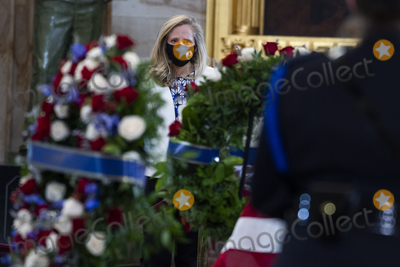 Photo - UNITED STATES - APRIL 13 United States Representative Abigail Spanberger (Democrat of Virginia) pays respects to US Capitol Officer William Billy Evans as his remains lie in honor in the Capitol Rotunda in Washington DC on Tuesday April 13 2021 Evans was killed when a driver rammed the north barricade of the Capitol on April 2 2021Credit Tom Williams  Pool via CNPAdMedia