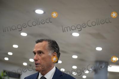 Photo - United States Senator Mitt Romney (Republican of Utah) talks with reporters as Senators make their way through the Senate subway during a vote at the US Capitol in Washington DC Wednesday July 21 2021 Credit Rod Lamkey  CNPAdMedia