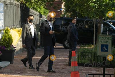 Photos From President Joe Biden departs from Holy Trinity Catholic Church
