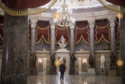Photo - United States Senator Patrick Leahy (Democrat of Vermont) walks alone back to the Senate side of the US Capitol after visiting the House chamber during a vote