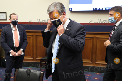 Photo - Replacing his face mask to reduce the risk posed by the coronavirus Federal Bureau of Investigation Director Christopher Wray leaves after testifying before the House Homeland Security Committee about worldwide threats to the homeland in the Rayburn House Office Building on Capitol Hill September 17 2020 in Washington DC Committee Chairman Bennie Thompson (D-MS) said he would issue a subpoena for acting Homeland Security Secretary Chad Wolf after he did not show for the hearing An August Government Accountability Office report found that Wolfs appointment by the Trump Administration which has regularly skirted the Senate confirmation process was invalid and a violation of the Federal Vacancies Reform ActCredit Chip Somodevilla  Pool via CNPAdMedia