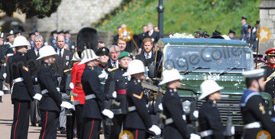 Wale Photo - Photo Must Be Credited Alpha Press 073074 17042021Prince Charles Prince of Wales Prince William Duke of Cambridge Prince Harry Duke of Sussex and Vice-Admiral Sir Timothy Laurence follow Prince Philip Duke of Edinburghs coffin on a modified Jaguar Land Rover during the Ceremonial Procession during the funeral of Prince Philip Duke of Edinburgh at St Georges Chapel in Windsor Castle in Windsor Berkshire No UK Rights Until 28 Days from Picture Shot Date AdMedia