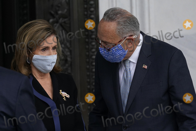 Photo - Speaker of the United States House of Representatives Nancy Pelosi (Democrat of California) and United States Senate Minority Leader Chuck Schumer (Democrat of New York) speak before standing at the top of the House steps of the US Capitol as they await the arrival of the casket of Justice Ruth Bader Ginsburg in Washington on Friday Sept 25 2020 Credit Alex Brandon  Pool via CNPAdMedia