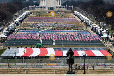 American Flag Photo - A view of the national mall from outside the Capitol as a giant American flag is unfurled in Washington DC on January 18 2021 Credit Erin Schaff  Pool via CNPAdMedia