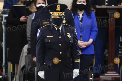 Photo - Acting US Capitol Police chief Yogananda Pittman stands as slain US Capitol Police officer William Billy Evans lies in honor at the Capitol in Washington Tuesday April 13 2021 Credit J Scott Applewhite  Pool via CNPAdMedia
