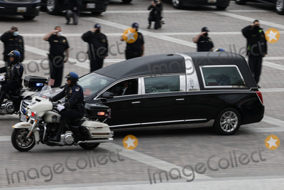 Photo - Police officers salute as a hearse carrying the casket containing the remains of late US Capitol Police officer William Evans who was killed in the line of duty on April 2 arrives at the US Capitol prior to a ceremony honoring Evans in Washington US April 13 2021 Credit Carlos Barria  Pool via CNPAdMedia