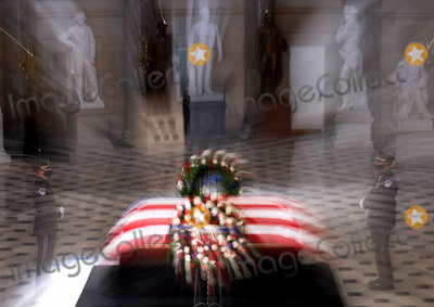 Photo - The flag-draped casket of the late Associate Justice Ruth Bader Ginsburg lies inside the Statuary Hall of the US Capitol September 25 2020 in Washington DCCredit Olivier Douliery  Pool via CNPAdMedia