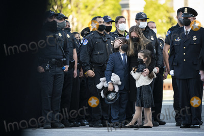 Photo - WASHINGTON DC - APRIL 13 Logan Evans son ShannonTerranova wife and Abigail Evans daughter watch and react as Capitol Police Officer William Billy Evans is carried out after laying in Honor on Capitol Hill on Tuesday April 13 2021 in Washington DCCredit Jabin Botsford  Pool via CNPAdMedia