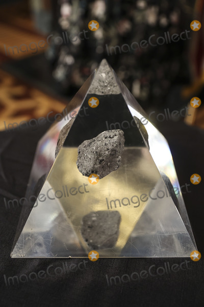 Photo - A moon rock encased in acrylic sits on a table ahead of Bill Nelson former Democratic Senator from Florida and administrator of the National Aeronautics and Space Administration (NASA) during a swearing in ceremony with US Vice President Kamala Harris in the Eisenhower Executive Office Building in Washington DC US on May 3 2021 The Senate confirmed Nelson on April 29 and had served as the chairman and ranking member of the Senate subcommittee that oversees NASA Credit Oliver Contreras  Pool via CNPAdMedia