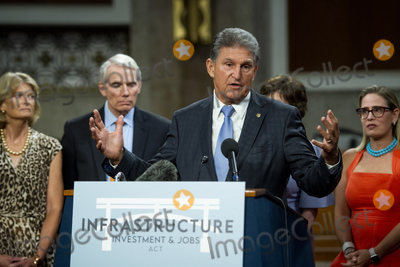 Photo - United States Senator Joe Manchin III (Democrat of West Virginia) makes remarks after the vote on the motion to invoke cloture to proceed to the consideration of HR 3684 the INVEST in America Act on Capitol Hill in Washington DC on Wednesday July 28 2021 The vote to begin discussion of the bipartisan infrastructure bill agreed to by the White House was 67 to 32 If passed the bill would invest close to 1 trillion in roads bridges ports and other infrastructure without a major tax increaseCredit Rod Lamkey  CNPAdMedia