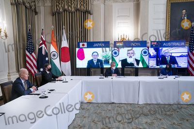 Antony Blinken Photo - From left to right at the table United States President Joe Biden US Secretary of State Antony Blinken Counselor to the President Jeffrey Zients and Sumona Guha Senior Director for South Asia National Security Council (NSC)meet virtually with their counterparts in the Quad from left to right on the monitors Prime Minister Yoshihide Suga of Japan Prime Minister Narendra Modi of India and Prime Minister Scott Morrison of Australia and  from the State Dining Room of the White House in Washington DC USA 12 March 2021Credit Jim LoScalzo  Pool via CNPAdMedia