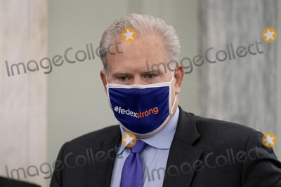 Richard Smith Photo - FedEx Express Regional President of the Americas and Executive Vice President Richard Smith arrives for a Senate Transportation subcommittee hybrid hearing on transporting a coronavirus vaccine on Capitol Hill Thursday Dec 10 2020 in WashingtonCredit Andrew Harnik  Pool via CNPAdMedia
