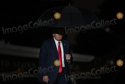 Photo - President Trump Returns to White House