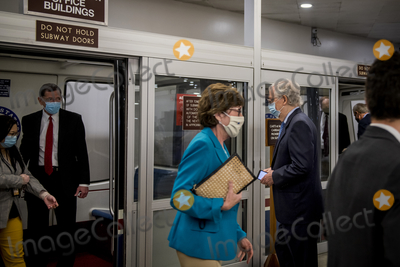 Photo - Senate Majority Leader Mitch McConnell R-KY makes his way to wait for a train in the Senate subway