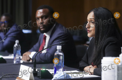 Ministry Photo - Leadership Conference on Civil  Human Rights President and CEO Vanita Gupta testifies as Doug Logan Jr president and professor of urban ministry of Grimke Seminary in Richmond Virginia and  attorney Lee Merritt listen during a United States Senate Judiciary Committee hearing to examine issues involving race and policing practices in the aftermath of the death in Minneapolis police custody of George Floyd and the civil unrest that followed on Capitol Hill in Washington US June 16 2020Credit Jonathan Ernst  Pool via CNPAdMedia