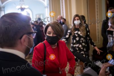 Photo - United States Senator Amy Klobuchar (Democrat of Minnesota) talks with reporters as she arrives at the Senate gallery at the US Capitol in Washington DC Tuesday September 14 2021 Credit Rod Lamkey  CNPAdMedia