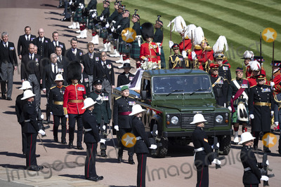 Wale Photo - Photo Must Be Credited Alpha Press 073074 17042021Princess Anne Princess Royal Prince Charles Prince of Wales Prince Andrew Duke of York Prince Edward Earl of Wessex Prince William Duke of Cambridge Peter Phillips Prince Harry Duke of Sussex Lord Viscount Linley Earl of Snowdon David Armstrong-Jones Viscount Lord David Linley and Vice-Admiral Sir Timothy Laurence follow Prince Philip Duke of Edinburghs coffin on a modified Jaguar Land Rover during the funeral of Prince Philip Duke of Edinburgh at St Georges Chapel in Windsor Castle in Windsor Berkshire No UK Rights Until 28 Days from Picture Shot Date AdMedia