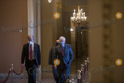 Photo - United States Senate Majority Leader Mitch McConnell (Republican of Kentucky) makes his way to the Senate Chamber from his office at the US Capitol