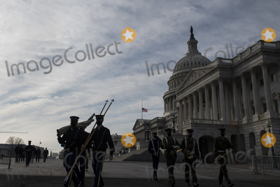Photo - Members of the Honor Guard walk past the US Capitol as preparations are made for the upcoming inauguration of President Joe Biden at the US Capitol in Washington DC Friday January 15 2021 Credit Rod Lamkey  CNPAdMedia
