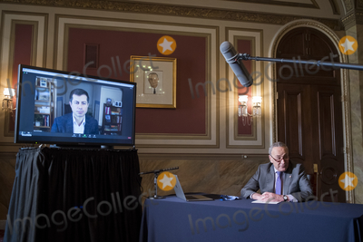 Photos From United States Senate Minority Leader Chuck Schumer (Democrat of New York) meets virtually with President-elect Bidens intended nominee for Transportation Secretary, Mayor Pete Buttigieg at the U.S. Capitol.