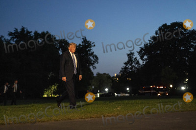 Photo - President Trump Arrives to the White House