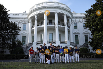 Group Photo Photo - United States President Donald J Trump poses for a group photo with Mariano Rivera and young players to mark the Opening Day of the Major League Baseball Season on the South Lawn of the White House in Washington on July 23 2020 Credit Yuri Gripas  Pool via CNPAdMedia