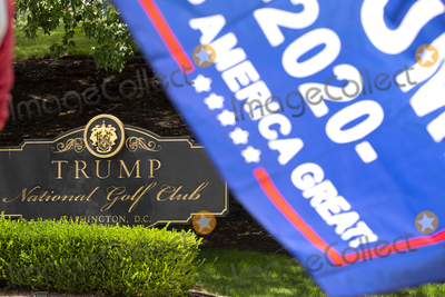 Photo - A supporter of United States President Donald J Trump holds a Keep America Great flag in front of Trump National Golf Club in Sterling Virginia on Sunday August 2 2020 as United States President Donald J Trump prepares to go back to the White House in Washington DC US  Credit Stefani Reynolds  CNPAdMedia