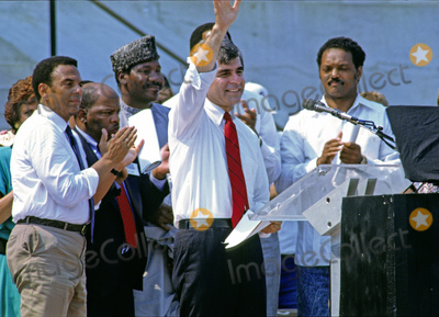 Andrew Young Photo - Governor Michael Dukakis (Democrat of Massachusetts) the 1988 Democratic Party nominee for President of the United States waves to the crowd as he prepares to make remarks at the 25th anniversary commemoration of Dr Martin Luther King Jrs March on Washington on the steps of the Lincoln Memorial in Washington DC on August 27 1988  Pictured from left to right Mayor Andrew Young (Democrat of Atlanta Georgia) United States Representative John Lewis (Democrat of Georgia) unidentified Governor Dukakis and the Reverend Jesse JacksonCredit Ron Sachs  CNPAdMedia